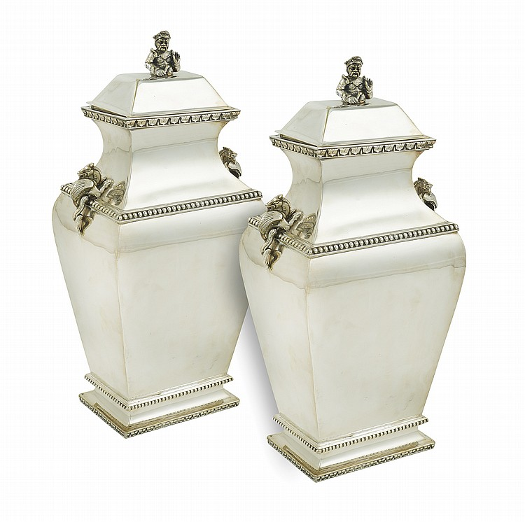 A pair of silver metal potiches