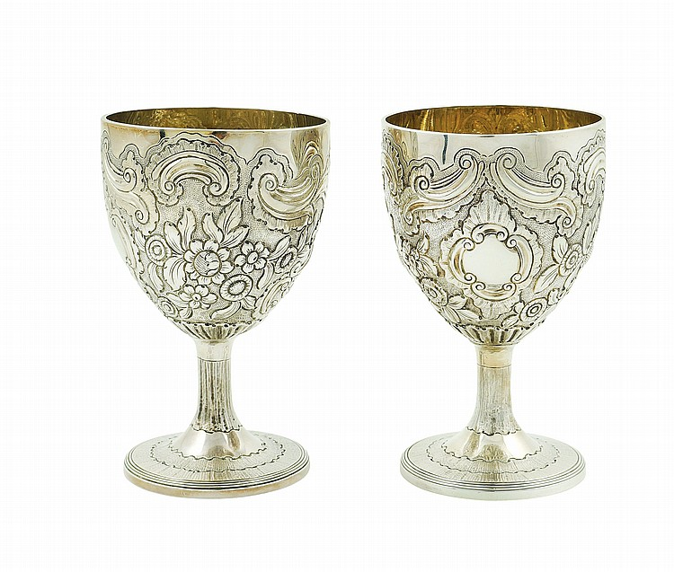 A pair of English silver chalice glasses
