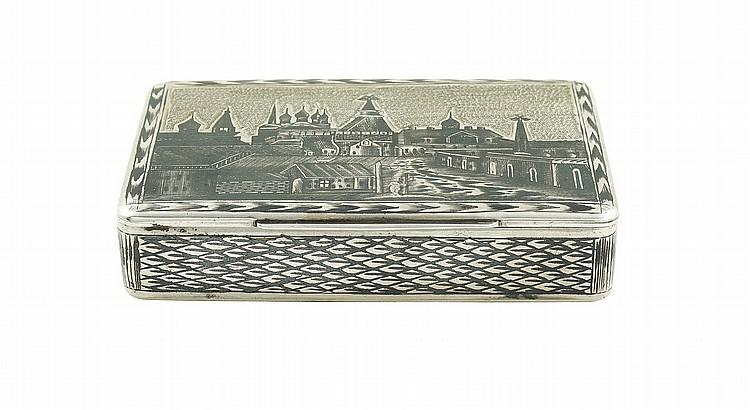 A silver box decorated in niello