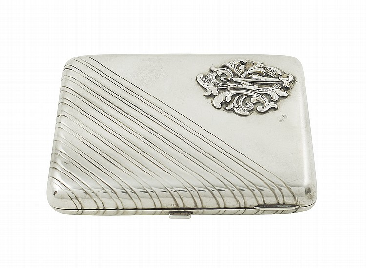 A Russian silver cigarette case with monogram