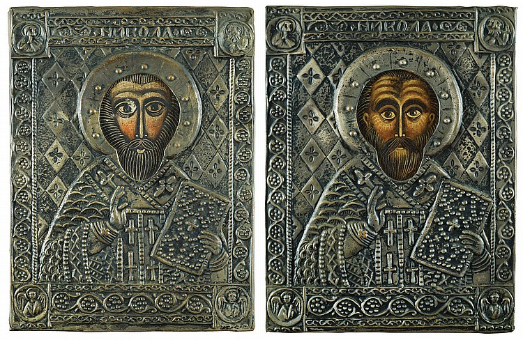 A pair of Russian icons with metal covers