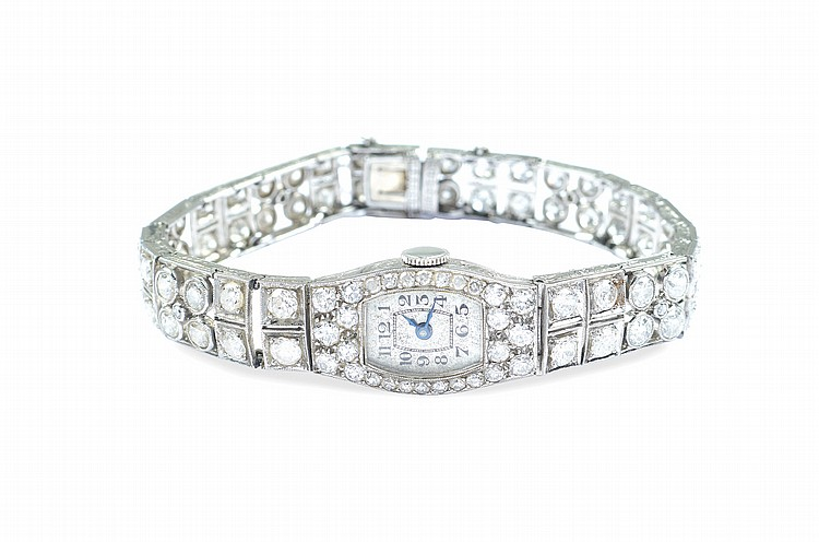 A platinum and diamonds bracelet watch