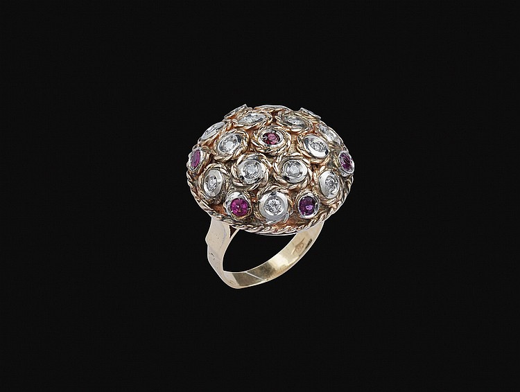 An 18kt pink and white gold ring with diamonds