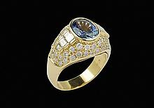 An 18kt gold trombino ring with a natural sapphire