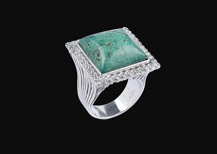 An 18kt white gold ring with a natural turquoise