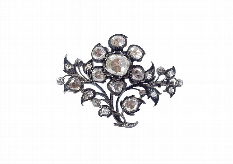 A gold and silver brooch with diamond roses