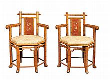 A pair of Oriental bamb¨ chairs