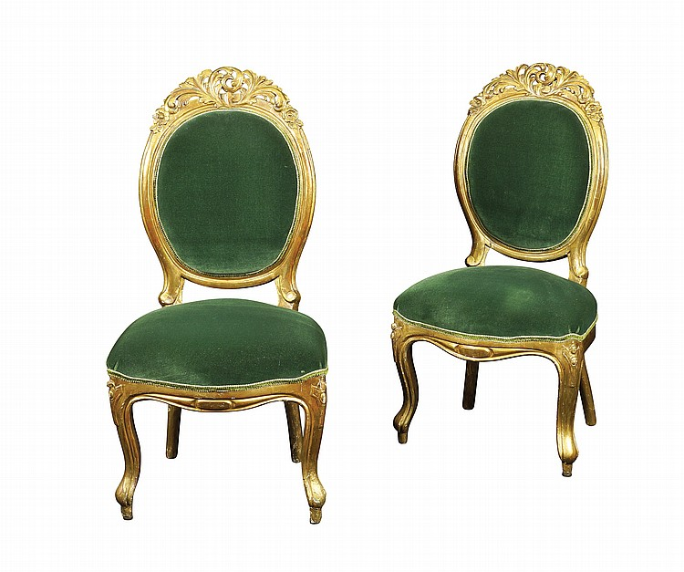 A pair of French gilded wood chairs