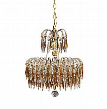 A gilt metal chandelier with refined crystal pendants