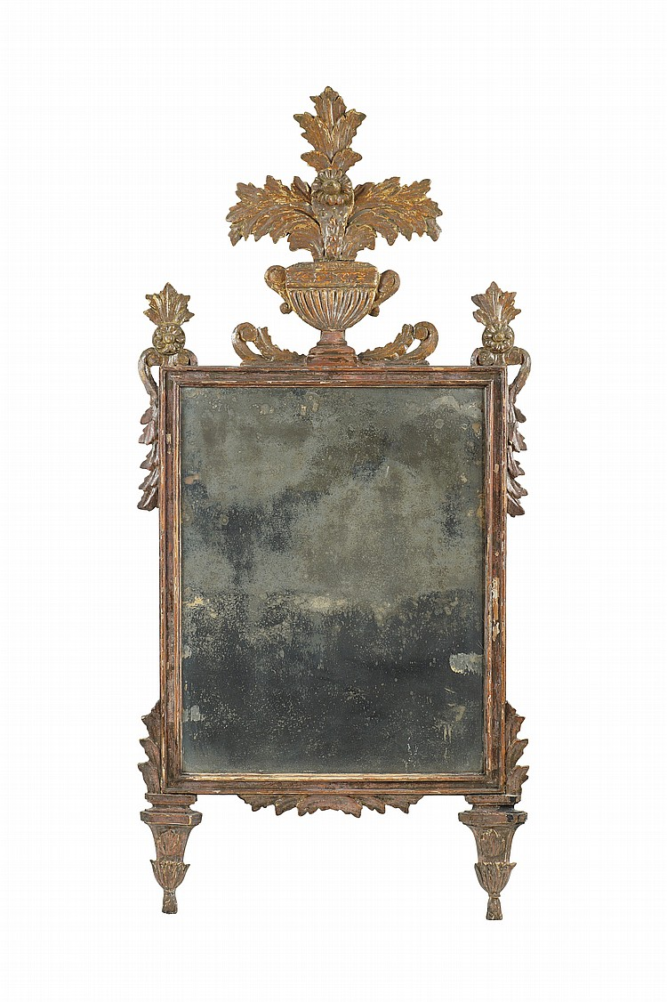 A gilt and chased wood mirror