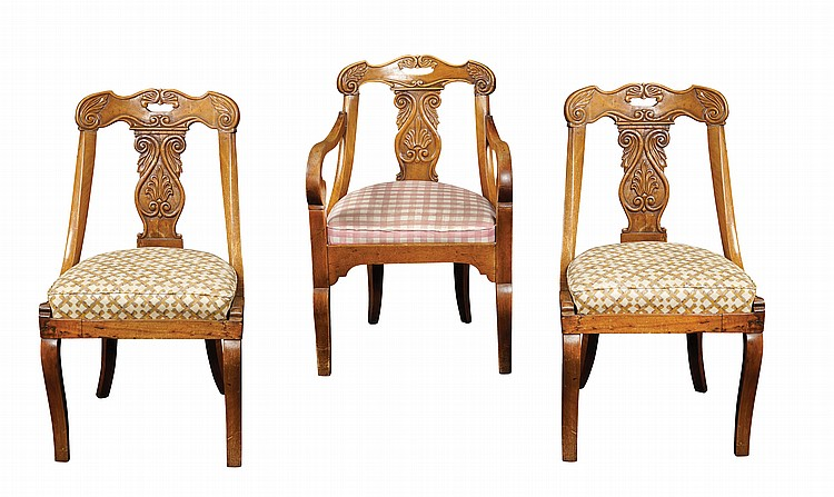 A carved walnut armchair and two carved walnut chairs