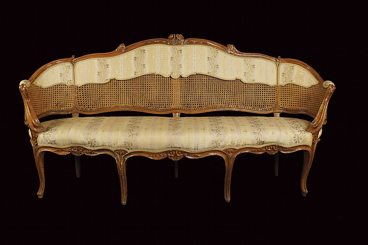 A French walnut sofa