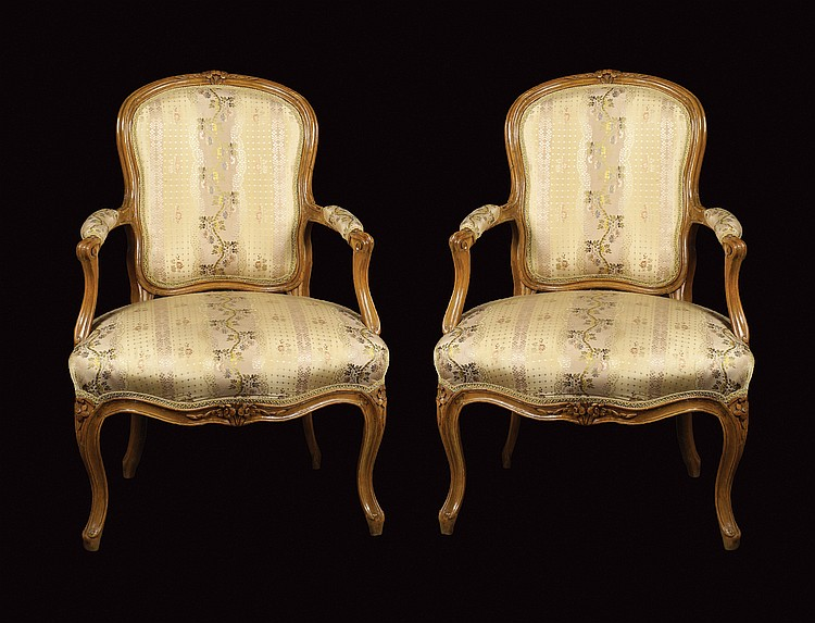 A pair of French walnut armchairs