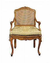 A French Louis XV carved walnut armchair