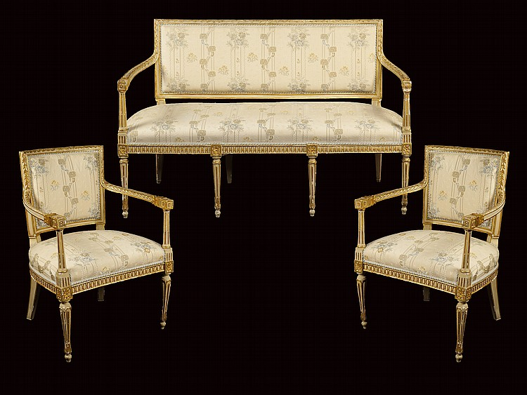 A sofa and a pair of armachairs in gilt and lacquered wood