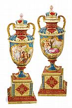 A pair of Vienna style porcelain vases