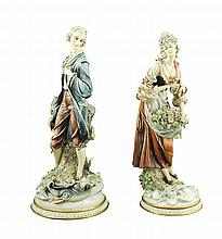 A pair of polychrome porcelain sculptures