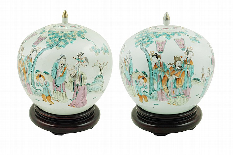 A pair of polychrome porcelain potiches