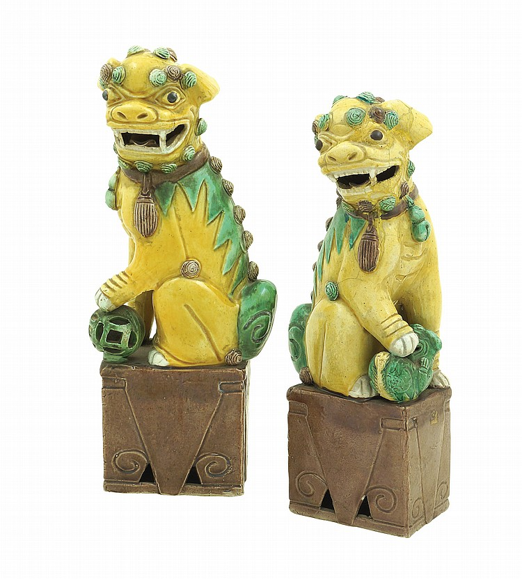 A pair of chinese ceramic foo dogs