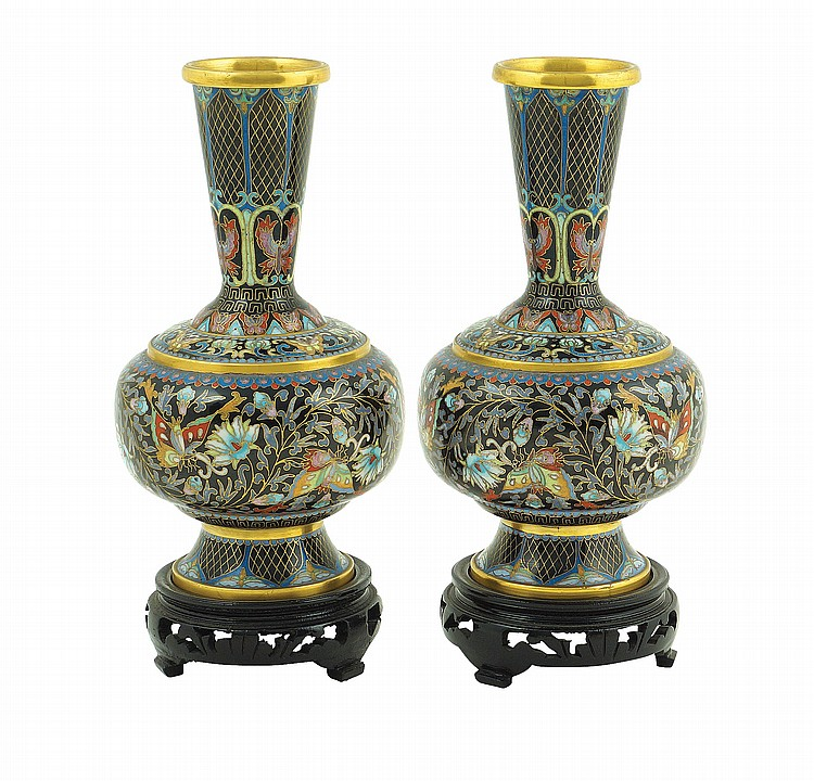 A pair of Oriental enamel cloisonne vases