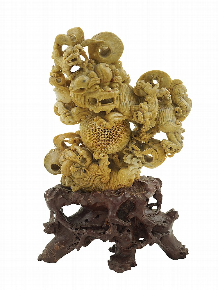 An Oriental yellow marble sculpture
