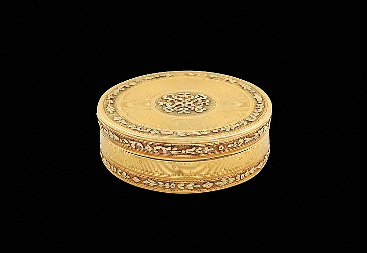 A Louis XVI two color gold circular snuff box