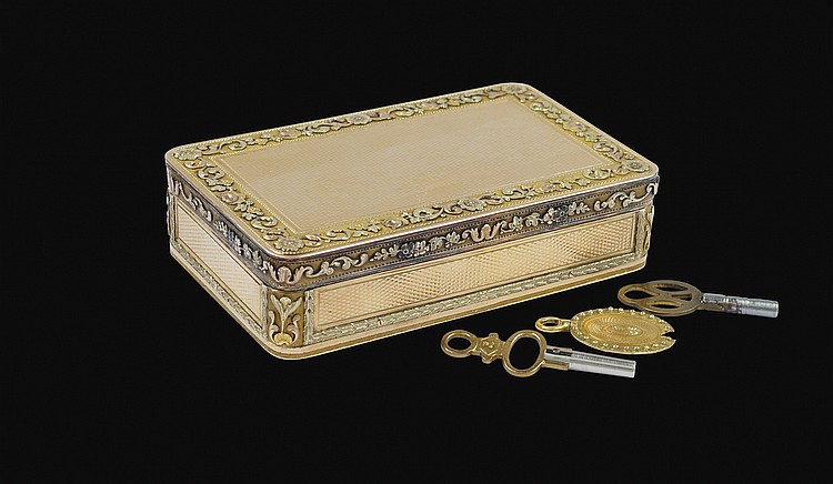 A Swiss gold music box