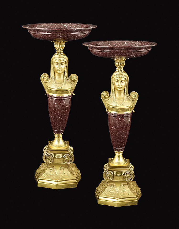 An important pair of red porphyry trays