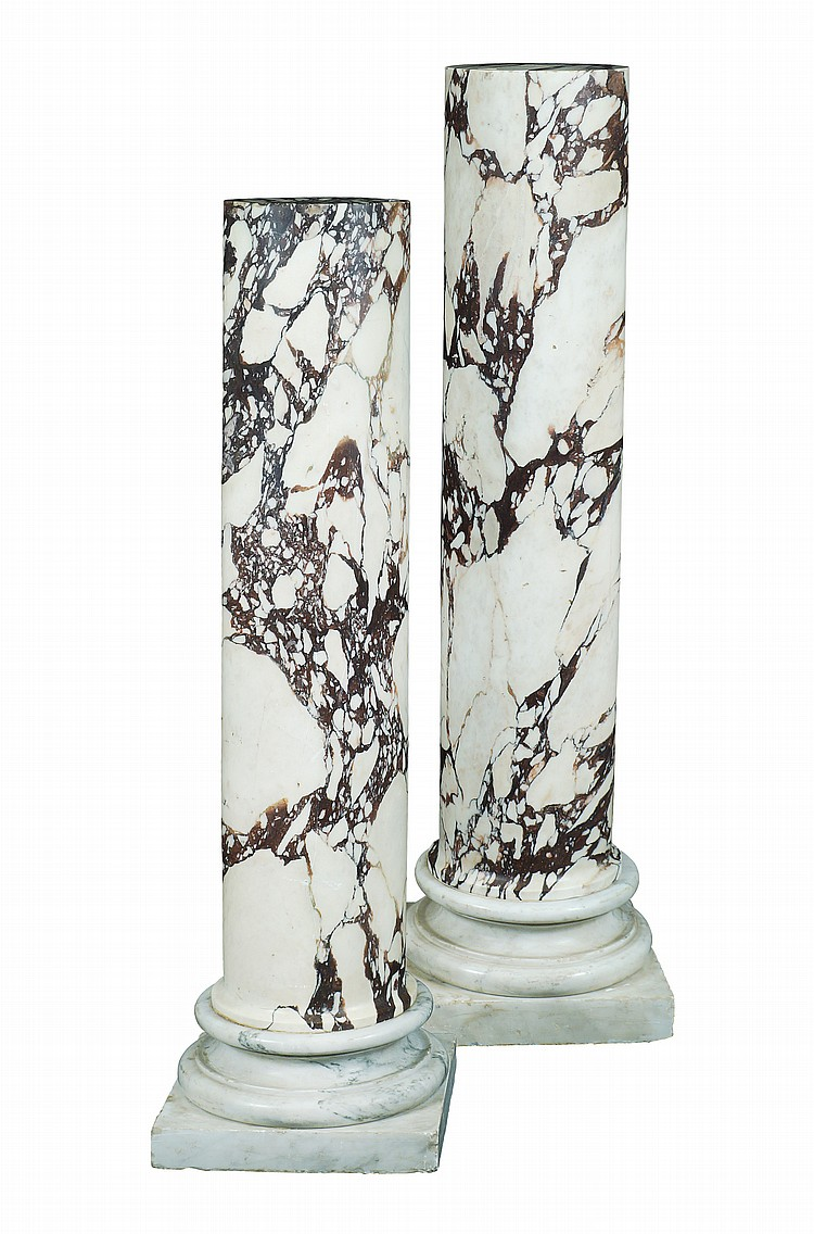 A pair of Italian pavonazzeto marble columns