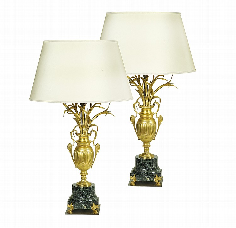 A pair of French gilt-bronze lamps