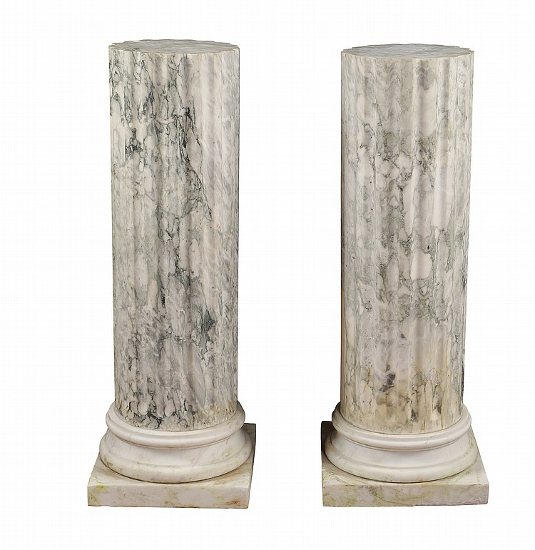 A pair of arabesque marble columns
