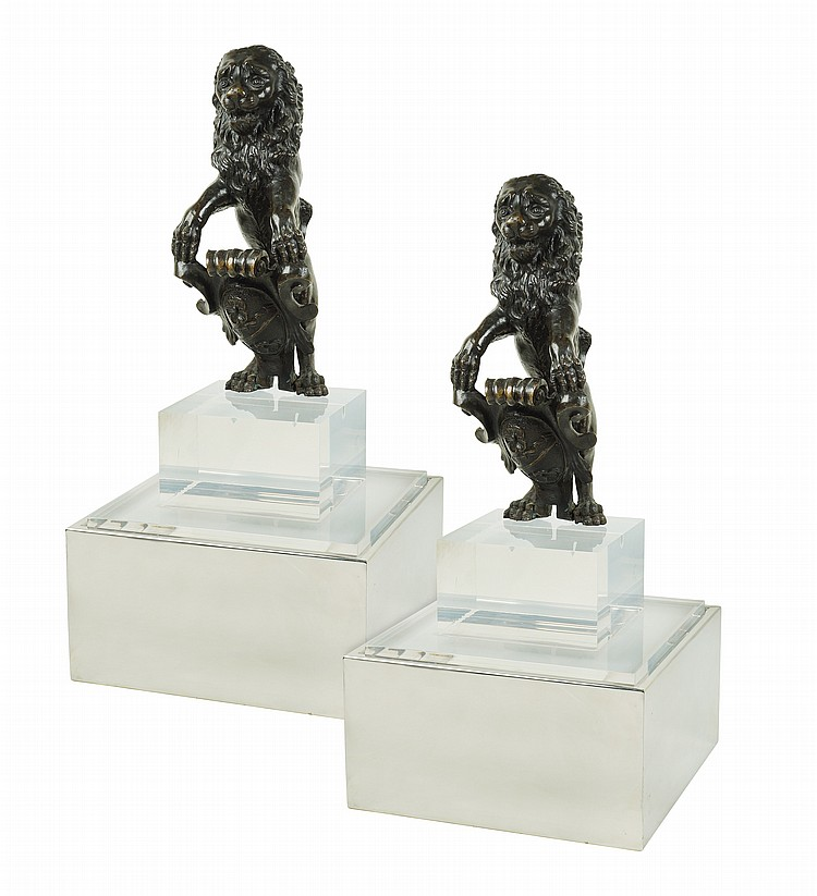 Two Italian bronze rampant lions