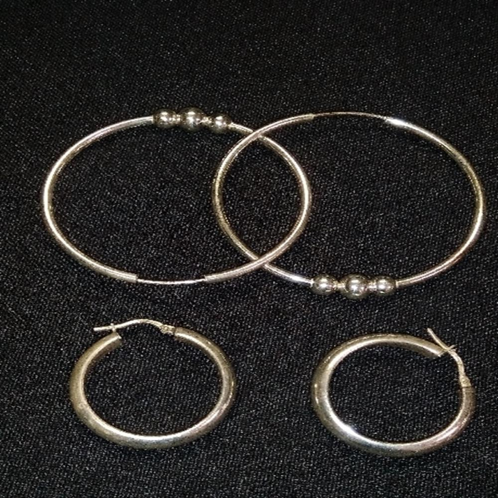 2 pairs of Unmarked Silver Hoop Earrings