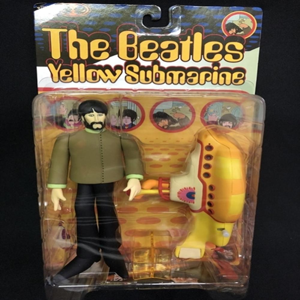 McFarland: Beatles George with Yellow Submarine