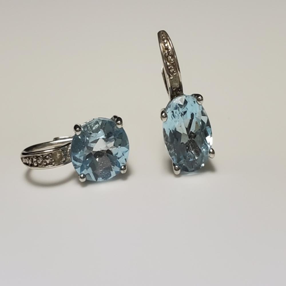 Lot 51: Lovely Powder Blue Topaz and 925 Sterling Earrings