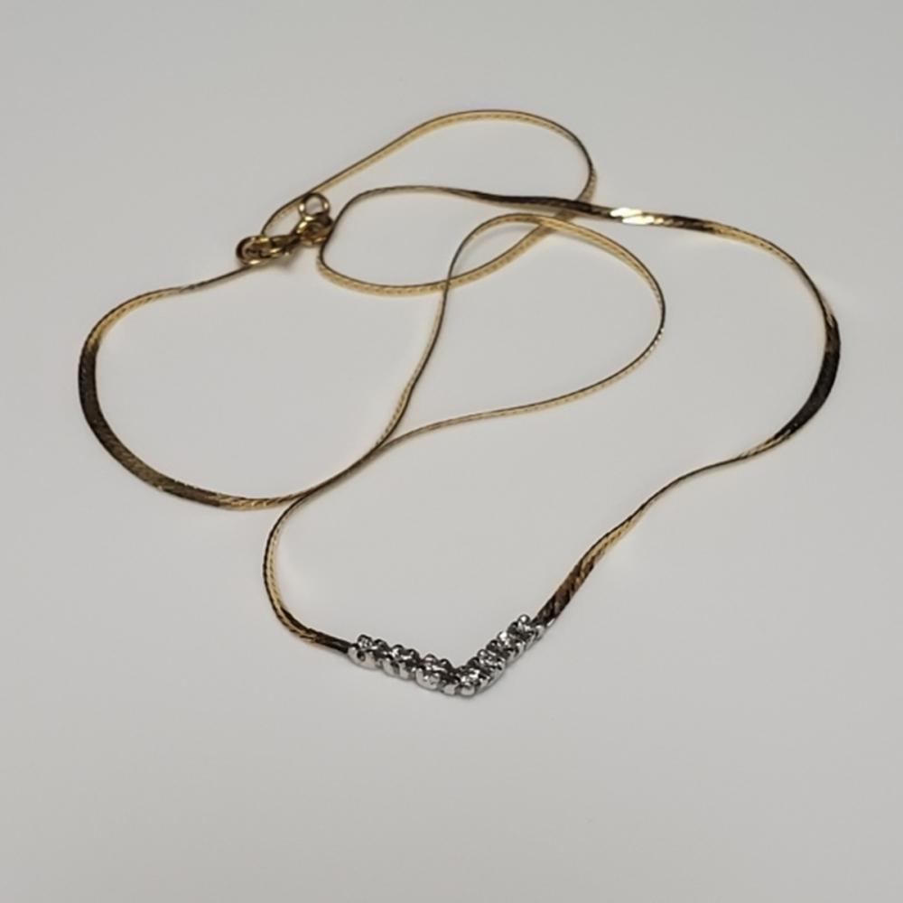 Lot 55: 14 Karat Yellow Gold and Diamond Necklace