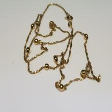 Lot 77: 18 Karat Yellow Gold Beaded Necklace