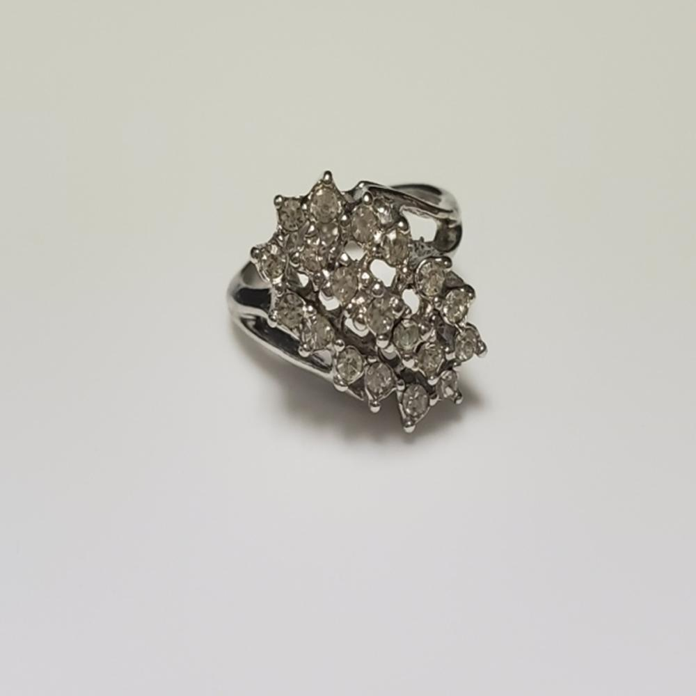 Lot 79: 18 KT HGE Cocktail Ring w/ White Tourmaline Stones
