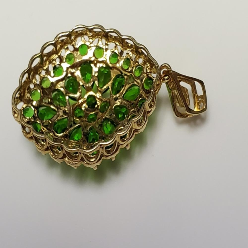 Lot 137: 14 Karat Gold with Lab Created Emerald Pendant