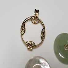 Lot 151: 14 Karat Gold Jade Interchangeable Disk Pendant