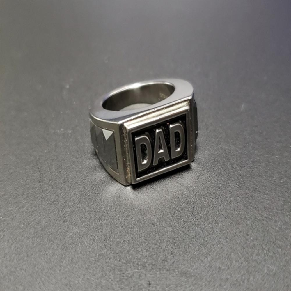 "Lot 153: Stainless Steel and Tungsten ""DAD"" Ring"