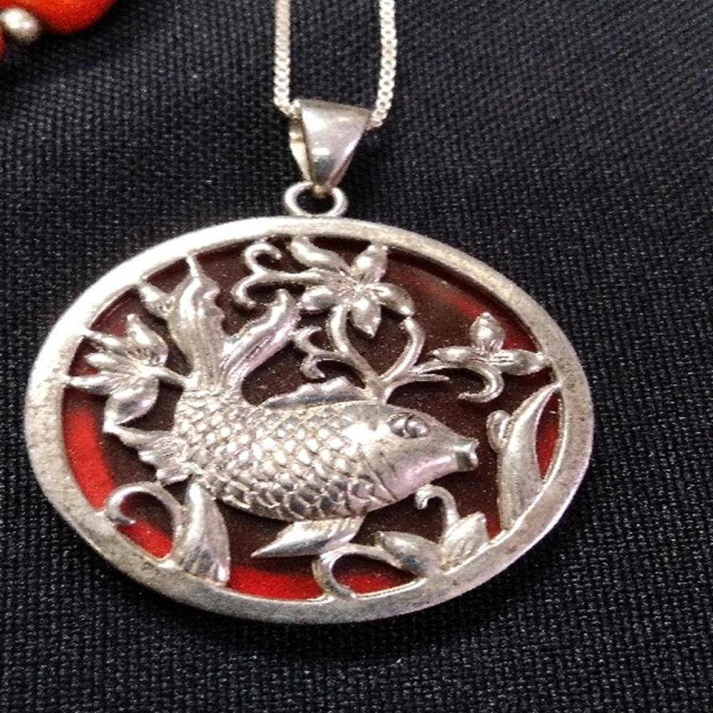Lot 189: Sterling Silver and Red Stone Jewelry Lot
