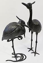 PAIR OF CAST IRON CRESTED CRANES. Chinese. Late