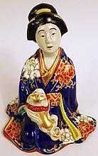 JAPANESE PORCELAIN FIGURINE OF A GEISHA. Seated