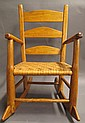 CHILD'S COUNTRY LADDER BACK ROCKER. WIth woven