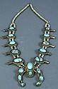 A NICE INDIAN SILVER AND TURQUOISE SQUASH BLOSSOM