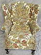 CHIPPENDALE STYLE CLAW FOOT WING BACK CHAIR. With