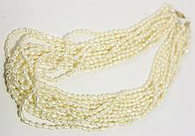 BAROQUE PEARL 10 STRAND NECKLACE. With 14k gold