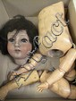 REVALO GERMAN BISQUE DOLL. With jointed