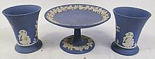 THREE WEDGWOOD ENGLAND BLUE JASPER TABLEWARES.- Tazza and two vases.